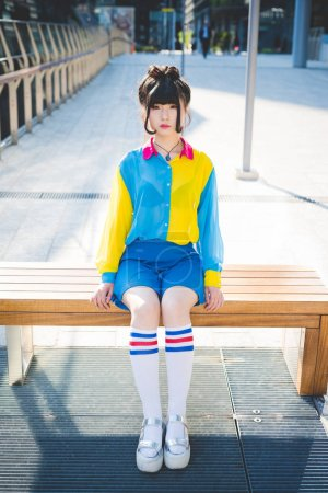 Woman sitting on wooden bench