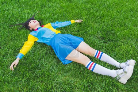 Woman laying on grass relaxing
