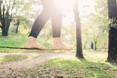 feet walking on tightrope