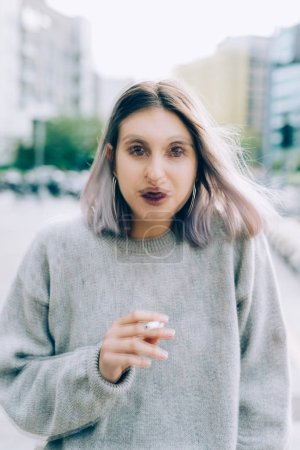 woman outdoor in city smoking