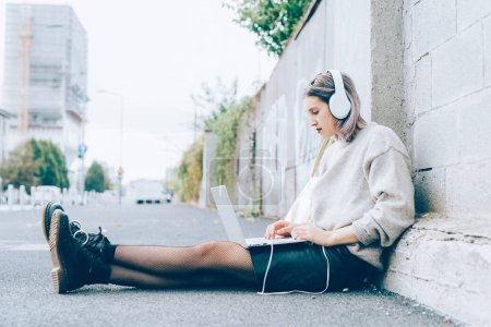 woman using computer listening music