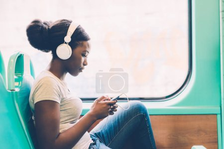 woman listening music travelling by bus