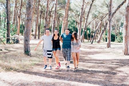 friends walking arm around outdoor