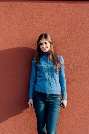 woman posing outdoor near wall
