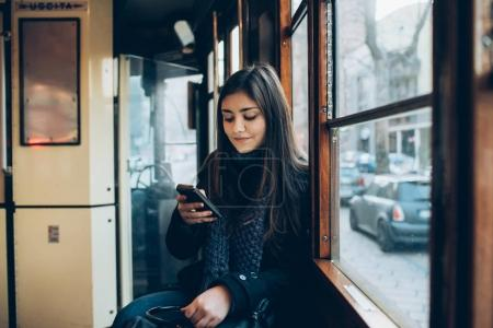 woman using smartphone in the transport