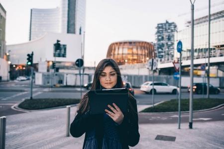 businesswoman outdoor using tablet