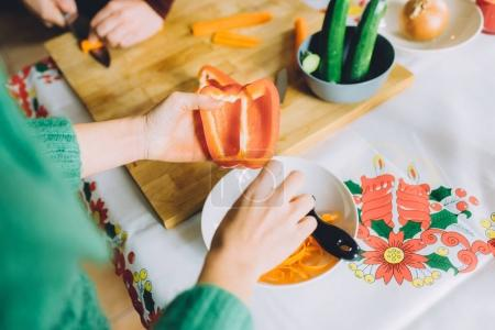 woman peeling pepper for dinner