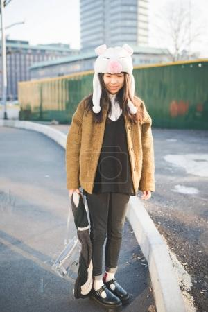 Photo for Young beautiful asian woman outdoor smiling wearing piggy hat - happiness, attitude, girl power concept - Royalty Free Image