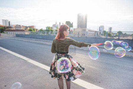 woman outdoor playing bubble soap