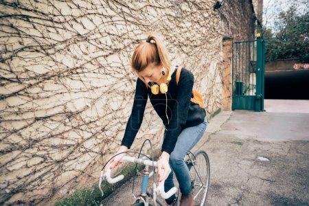 young beautiful woman outdoor cycling