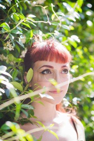 portrait young woman beautiful posing outdoor looking sideways