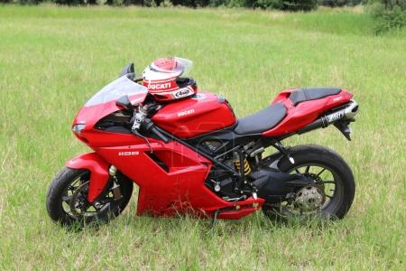 Parked red Ducati 1198 motorbike