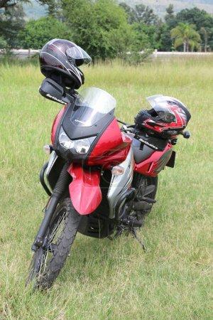 Parked red Kawasaki motorbike on