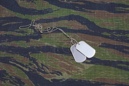 us army tiger stripe camouflaged uniform with blank dog tags