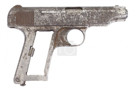 Old rusty pistol isolated on white
