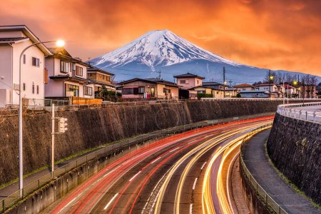 Mt. Fuji, Japan over roads at dusk.