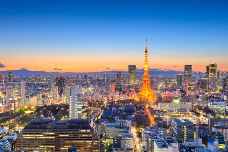 Photo for Tokyo, Japan downtown cityscape in the Minato Ward at dusk with the tower and Mt. Fuji in the distance on the horizon. - Royalty Free Image