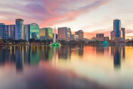 Photo for Orlando, Florida, USA downtown city skyline from Eola Park at dusk. - Royalty Free Image