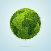 World globe shape of green grass isolated on blue background