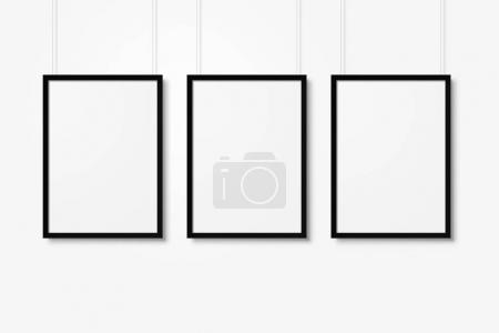 Photo for White blank photo frames mockup with ropes isolated over white background - Royalty Free Image