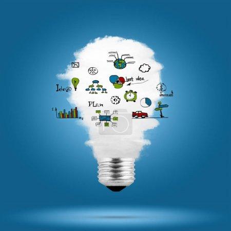Photo pour Ampoule avec nuage à l'intérieur et croquis d'entreprise sur fond bleu - image libre de droit