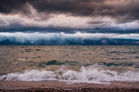 Photo for View of storm seascape with wave, cloud and mountain - Royalty Free Image
