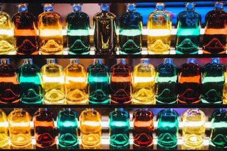 Different bottles on shelves