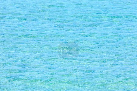 Photo for Blue sea flowing water surface with waves and sun glitters. Abstract background pattern. - Royalty Free Image