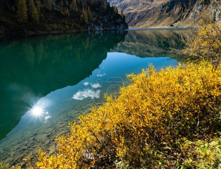 Photo for Sunny autumn alpine Tappenkarsee lake and rocky mountains above, Kleinarl, Land Salzburg, Austria. Picturesque hiking, seasonal, and nature beauty concept scene. - Royalty Free Image