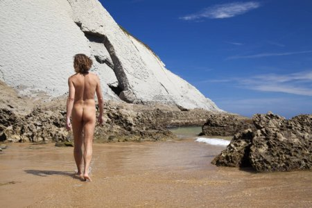 Male nudist on Playa de Covachos beach, Cantabria,...