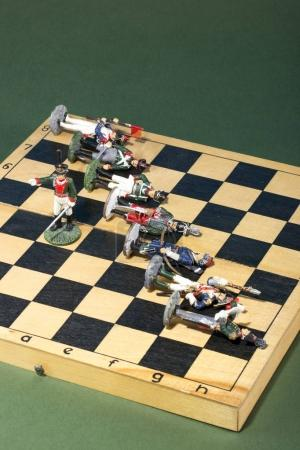 Photo for Tin soldiers of the Napoleonic wars of 1812 on a chessboard - Royalty Free Image