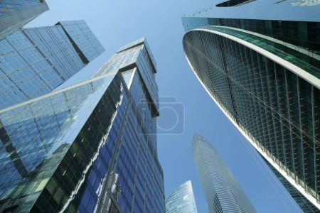 Photo for MOSCOW, RUSSIA - AUGUST 13, 2017: Low angle view of Moscow-City skyscrapers. Moscow-City (Moscow International Business Center) is a modern commercial buildings with a futuristic design in downtown. - Royalty Free Image