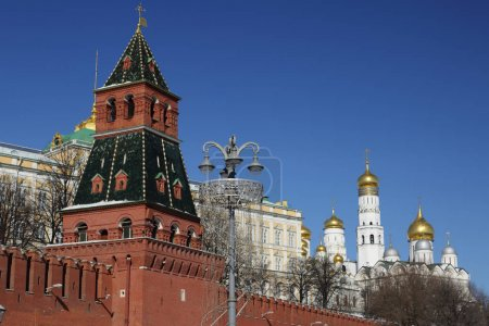 Photo for Outdoor view on Kremlin in details from the background of Kremlevskaya embankment at sunny day in early spring. - Royalty Free Image