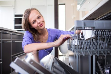 Pretty, young woman in her modern and well equiped kitchen
