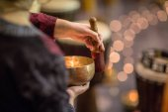 Woman playing on a tibetian singing bowl