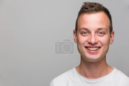 Photo for Portrait of a handsome young man, perfectly calm, facing the camera with emotionless expression - Royalty Free Image