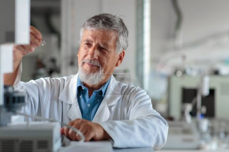 Photo for Senior chemistry professor/doctor in a lab (color toned image) - Royalty Free Image