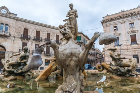 Photo for Famous Artemis (Diana) Fountain on Archimedes Square on the Ortygia isle - old town of Syracuse on Sicily island, Italy - Royalty Free Image