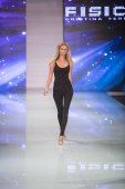 A model walks the runway during the Fisico by Cristina Ferrari Fashion Show Resort 2018 Collection in Miami Fashion Week 2017 at the Ice Palace in Miami on June 3rd, 2017