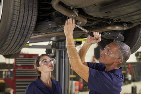 Male And Female Mechanics Together