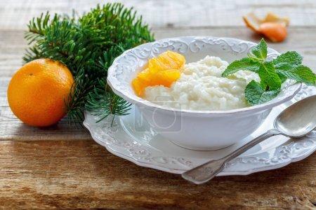 Rice porridge with slices of tangerine.