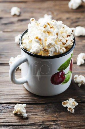 Popcorn in metal mug