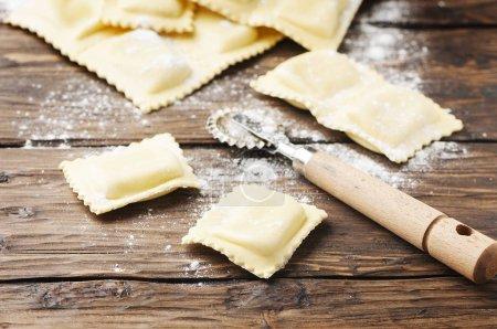 Uncooked ravioli on table