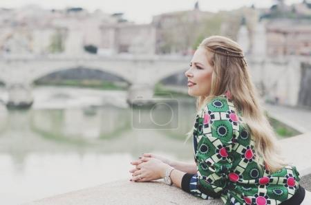 Happy young hipster woman in Rome