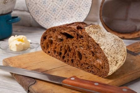 Homemade rye bread on old cutting board