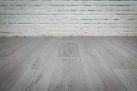 Photo for Old white brick wall and grey wood floor background - Royalty Free Image