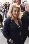 Catherine Deneuve attends Jean Paul Gaultier