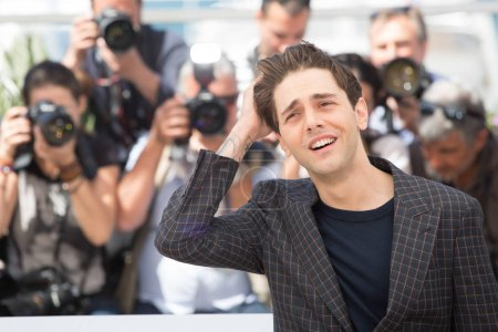 Photo for CANNES, FRANCE - MAY 19: Xavier Dolan attends the 'It's Only The End Of The World (Juste La Fin Du Monde)'  photocall during the 69th annual Cannes Film Festival at the Palais des Festivals on May 19, 2016 in Cannes - Royalty Free Image