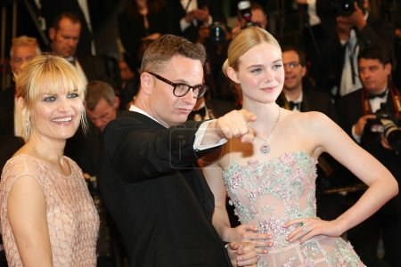 Photo for CANNES, FRANCE - MAY 20, 2016: Nicolas Winding Refn, Liv Corfixen, Elle Fanning  attends the 'The Neon Demon' Premiere. 69th annual Cannes Film Festival at the Palais des Festivals - Royalty Free Image