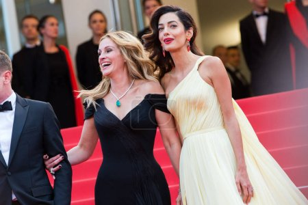 """Photo for CANNES, FRANCE - MAY 12: Julia Roberts, Amal Clooney attend the screening of """"Money Monster"""" at the annual 69th Cannes Film Festival at Palais des Festivals on May 12, 2016 in Cannes, France. - Royalty Free Image"""
